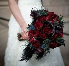 There's no bride without a bouquet! Halloween weddings are unique and I think that every touch and detail on your big day should be unusual. A traditional Halloween wedding bouquet is dark red roses or callas...