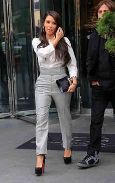 Kim Kardashian in a Alexander McQueen jumpsuit, Hermes clutch, & Christian Louboutin Daffy pumps.