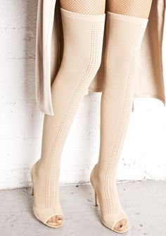 Myth Thigh-High Sock Boots ...we never thought we'd get to see you in the flesh, babe. These ultra hott thigh-high sock boots feature a chic pull-on style, nude structured stretch knit that grips your curves, peep toe, and spiked stiletto heels.