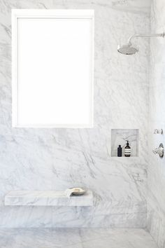 Gorgeous all marble bath with bench and large window