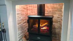 Inside of a log burner Log Burner, Stove, Home Appliances, Wood, House Appliances, Wood Burning Heaters, Range, Woodwind Instrument, Wood Furnace