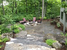 XL Flagstone Patio with Granite in-gound firepit this is the view from the upper level patio