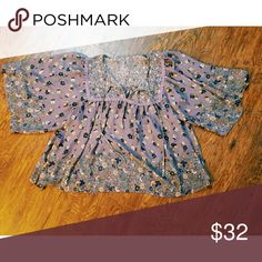 Peasant top I love the aura of this flirty feminine peasant top, lace trim, beautiful lavender color with navy and cream color flowers Tops