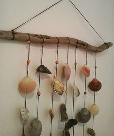 This handmade wall hanging is made by me from individually selected shells and driftwood sourced from the beaches of the Central Coast in NSW Australia. I have also incorporated lovely wooden beads. It measures 59 cms (23 inches) wide by 94 cms (37 inches) long (not including the