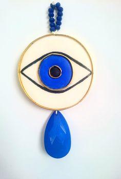 modern evil eye wall hanging, crying eye ornament