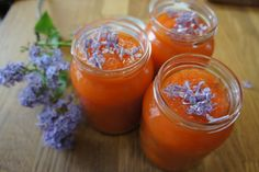 young carrots with marzipan and lilac flowers