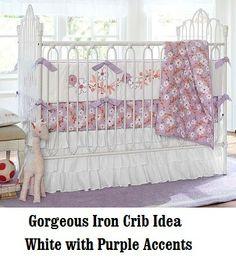 Iron Crib. White with purple accents - adorable! #whitecrib #crib #ironcrib