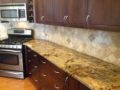 backsplash installation in Tampa, Florida (Westchase).    4x4 Medium River tumbled travertine set diagonal with a 2x2 Noce accent here and there.
