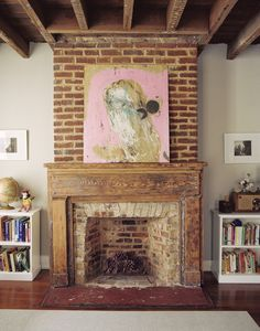 exposed brick and wood fireplace mantle art display Exposed Brick Fireplaces, Old Fireplace, Rustic Fireplaces, Fireplace Surrounds, Fireplace Design, Exposed Beams, Painting Fireplace, Fireplace Frame, Craftsman Fireplace