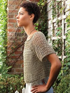 """Knit a light and airy top with a lacy look.   This breezy and open pullover is worked in an easy 4-row lace pattern with a larger gauge to create a light and lofty look. Knit with 4 (5, 5, 6, 7, 7, 8) hanks of Berroco® Captiva™ or approximately 392 (490, 490, 588, 686, 686, 784) yds of worsted-weight yarn at a gauge of 16 sts and 16 rows per 4"""" using U.S. size 7/4.5mm needles."""