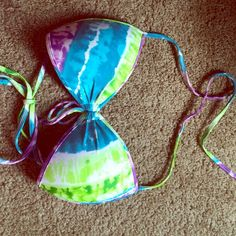 Cute multiple colored swim top💕 Worn a couple of time the size says small but it fits a medium. It's to big for me so not much use to me!❤️ Swim Bikinis