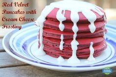 Red Velvet Pancakes with Cream Cheese Frosting - If you want to treat your sweetheart to breakfast in bed this Valentine's Day, this is perfect! Recipe uses a boxed cake mix, so it's super easy!