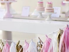 Tassel garlands are perfect for weddings! Learn how to make your own here >> http://www.hgtv.com/design/make-and-celebrate/entertaining/diy-wedding-decor-anyone-can-make-pictures?soc=pinterest