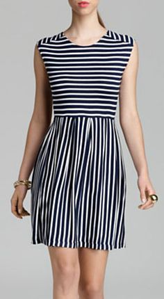 This navy-and-white striped dress is less harsh for spring than, say, a play-it-safe black dress.     Where to buy and what to wear with it: http://blog.womenshealthmag.com/beauty-style-buzz/dinner-date/