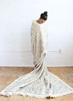Amazing handira wedding blanket filled with metallic sequins, from Baba Souk