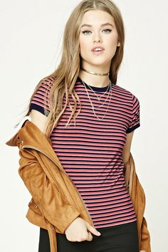 A knit ringer tee featuring an allover striped pattern, contrast trim, a round neckline, and short sleeves.
