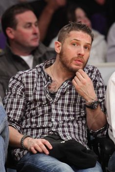 Oh, what is that I see peeking out of your shirt? A tattoo? Well  Tom Hardy as if you hadn't already won our hearts..