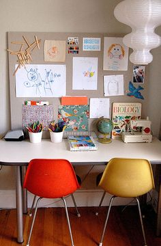 simple workspace. white pencil holders. inspiration board.