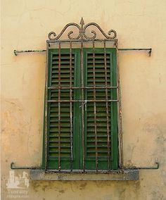 An old Tuscan window with decorative bars. #Tuscany #Italy