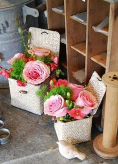 ...it's hip to be square...fun mini arrangements we did in square baskets filled with quince, roses, hypernicum and trick dianthus...