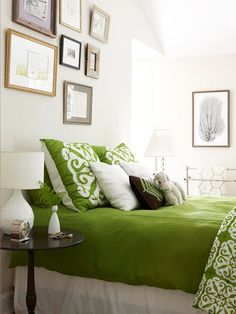 Bedroom - I love the grown-up, sophisticated, and eclectic nature of this room. The tree green color palatte, and the use of white to shed light on it, is bold, refreshing, and earthy. I would love to recreate the use of different frames in place of a headboard to make the space more personal. There is also something pure and elegant about the single stem fern standing in the miniature vase on the nighttable.