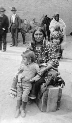 Medicine Crow's wife and son, (Crow), 1900