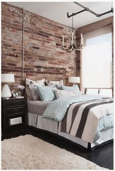 Industrial Bedroom Design with Pipes and Brick Wall