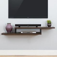 Perfect for storage or display on any wall in your home, the modern Martin Furniture Ascend Wall Mounted TV Shelf features the look of floating shelves. Wall Mount Tv Shelf, Wall Tv, Shelf Wall, Mounting Tv On Wall, Bedroom Tv Wall, Corner Wall, Wood Wall, Hanging Tv, Hanging Cabinet