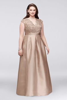 This beautiful plus-size ball gown features a full, shimmering mikado skirt and a flattering V-neck lace bodice. By Chetta B Polyester Back zipper; fully lined Dry clean Imported Also available