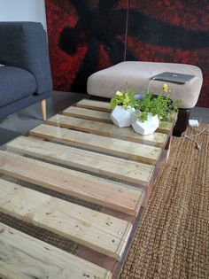 Unstained pallet coffee table with toughened glass top.