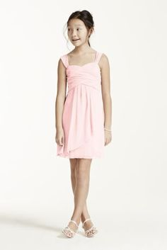 A sweet and chic look that will be perfect for any junior bridesmaid!  Ruched bodice with sweetheart neckline features ultra-feminine cap sleeves.  Cascade front is fun and give this dress layers of movement.  This style features an adjustable fit for added flexibility and comfort with fewer alterations.  Fully lined. Back zip. Imported polyester. Dry clean.