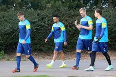 Aaron Ramsey Photos Photos - Aaron Ramsey, Per Mertesacker and Wojciech Szczesny make their way to the training field during a Arsenal Training Session ahead of their Champions League fixture against Borussia Dortmund on September 15, 2014 in St Albans, England. - Arsenal Training Session