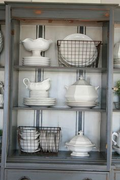 love the back splash! dishes in wire baskets! Cute idea. Found Here: http://www.etsy.com/listing/124196493/vintage-wire-locker-basket?ref=shop_home_active