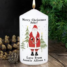 Personalise this Father Christmas Candle with the any name or message over 2 lines above the illustration of up to 15 characters per line and with 2 lines below the illustration with up to 15 characters per line.  #ChristmasGifts
