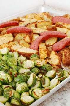 @tiffanyaking creates another delicious-looking sheet pan dinner using smoked sausage, Brussels sprouts and potato wedges.
