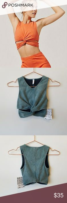 Free People Movement Supernova Sports Bra Top RARE COLOR - NWT  Attempted to try on and realized this runs small. This would work best for XXS but if you are a true XS and have small shoulders this may work for you but it will be a tight fit.  Color is a slate green, rare color, tags are still attached.  Fabric has a faded look to it and is purposely made to look like it has some wear...but it is BRAND NEW I can assure you. Free People Tops Crop Tops