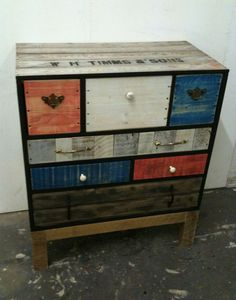 From and old crate, love the rustic but colorful drawers.