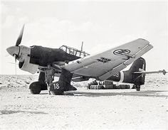 One of ten Ju-87's, German-built 'Stuka' dive-bombers, manned by Italian crews, which forced-landed on or near British lines in Africa. This plane was flown back to RAF base by RAF wing commander. It was only one of ten salvagable, others were crash-landed. Italian pilots accused Germans who serviced their machines with only half-filling their tanks. Pin by Paolo Marzioli