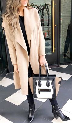 #winter #outfits black top, black jeans, boots, long beige boots