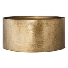 """• Metal coffee table with antique copper finish<br>• Nail hammered accent for textured feel<br><br>The metal Granby Hammered Barrel Coffee Table – Threshold is on-trend with a antique copper finish you'll love. The table is perfect for your living room – add a little flare to your space with this unique piece. 12""""Hx29.5""""Wx29.5D"""""""