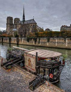 Notre Dame and Restaurant boat, Paris.