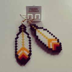 Feather earrings made from perler beads.