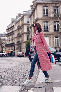 Perfect look for strolling in Paris wearing white and red trench coat and Chanel sneakers - Paris Fashion Week outfit