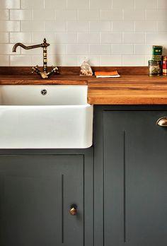 brass hardware, butcher block countertop, apron sink, painted cab