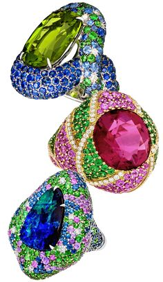 From top to bottom: Margot McKinney Vert rings with 13.61 cts peridot; Amarathine ring with 14,70 cts rubellite and Opal Garden ring with Australian opal 8,69 cts