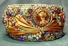 """~~""""Aurora's Jewels"""" is the name of this silk and bead embroidery bracelet by Gail Nettles~she named it this because the colors made her think of the sunrise...and Aurora is the goddess of the dawn in Roman mythology~~"""