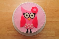 Owl Smash Cake - My client requested this cute little owl for her daughter's first birthday smash cake. It was made to match her decorations. It is a white cake with strawberry filling and vanilla buttercream. The owl is made with fondant and buttercream accents. TFL!