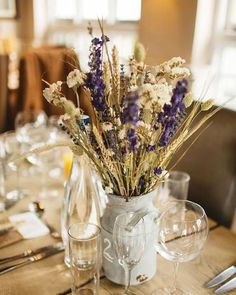 @curiouscountry posted to Instagram: Look at this beautiful dried flower and grain wedding centerpiece!  Create this look by shopping in our store for dried wheat, phalaris grass or club wheat, lavender, statice, everlasting flowers, and dark blue larkspur.  Your guests will love these centerpieces!  And you can use them to decorate your new home after your wedding!   #weddinginspo #weddingreception #receptionideas #bohowedding #weddingideas #weddingdecor #weddingbouquet #bridetobe #bridalbouque