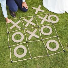 Bring the fun outdoors with this classic game of giant outdoor noughts and crosses - keep the little ones entertained with some outdoor wedding games. Nothing says summer wedding like garden games - this one is easy and fun with no assembly required, just lay out and play! Each pack includes 1 x 1m square rope game board and 5 x Os measuring 25cm (D) and 5 x Xs measuring 25cm(H) x 25xm(W). Wedding Yard Games, Outdoor Wedding Games, Wedding Reception Games, Outdoor Games, Wedding Games For Kids, Wedding Receptions, Diy Wedding, Country Wedding Games, Outdoor Drinking Games