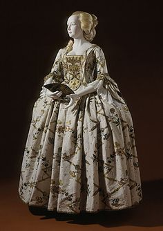 England  Woman's Gown, circa 1730-1740  Costume/clothing principle attire/entire body; Costume/clothing principle attire/lower body, Brocaded silk, linen lining, a) Gown: Center back length: 48 1/4 in. (122.55 cm); b) Petticoat: Center back length: 39 1/8 in. (99.38 cm)  Costume Council Fund (M.57.24.2a-b)